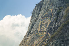Buddha on cliff Stock Images