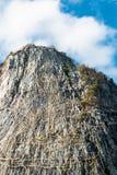 Buddha on cliff Stock Photos