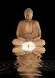 Buddha Contemplation. Buddha in contemplation with a glowing white lotus lily and reflection in rippled water, over black background stock photography