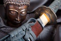 Buddha contra la espada Imagenes de archivo