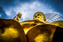 Buddha at Da Lat temple. Golden statue of Buddha at Da Lat (Dalat) temple, Vietnam, blue sky and cloud background Stock Photos