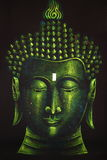 Buddha. Depicted on a black background in green Stock Image