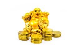 Buddha di risata con le monete di oro Immagini Stock