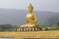 Buddha and disciple statues Stock Images