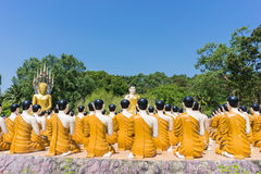 Buddha with disciple at Thai temple.  Royalty Free Stock Image