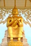 Buddha dorato di seduta Fotografie Stock