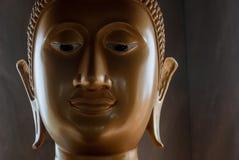 Buddha dourado enfrenta imagem de stock royalty free