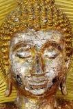 Buddha dourado enfrenta o close-up da estátua, estátua de buddha Fotos de Stock Royalty Free