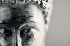 The buddha in duotone. Detail of the face of a representation of the buddha with his eyes closed in duotone royalty free stock images