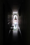Buddha at the End of a Dark Hallway Stock Photos