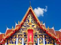 Buddha enshrined in a temple gable Stock Photos