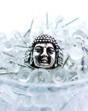 Buddha is everywhere. Conceptual metaphor, Buddha is everywhere, in your home, in your office, on your screen, even in a box of thumb tacs Royalty Free Stock Photography