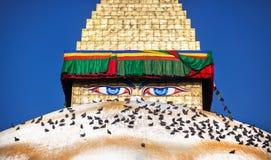 Buddha eyes on Bodhnath stupa. Buddha eyes close up on golden tower at Bodhnath stupa in Kathmandu valley, Nepal Stock Photo