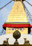 Buddha eyes of Bodhnath stupa and wheel of Dharma with two deers stock images