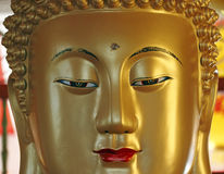 Buddha face. A close-up face image of a golden statue of Buddha royalty free stock photo