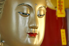 Buddha face. A close up image of a golden statue of Buddha's face royalty free stock photography