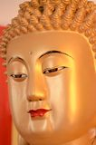 Buddha face. Sculpture of golden Buddha face in Bali Stock Image