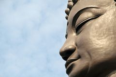 Buddha face. Against blue sky Stock Photo