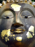 Buddha face. Buddha statue's face with goldleaf in Bangkok royalty free stock photo