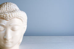 Buddha face. Buddha statue made of white marble with free space for text. Concept of peace, calm and tranquility Royalty Free Stock Image