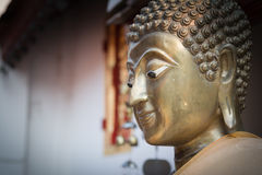 Buddha face. Close up gold Buddha face statue Royalty Free Stock Image