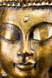 Buddha face. Golden buddha face close up Stock Photos