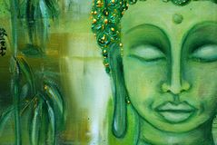 Buddha face on green stock photo