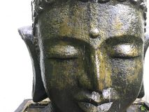 Buddha face. Isolated Buddha face statue Stock Image
