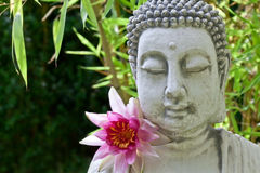 Buddha face, lotus flower and bamboo Royalty Free Stock Images