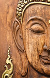 Buddha' face, made from teak wood in Thai style Royalty Free Stock Photography