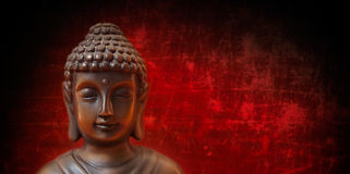 Buddha. Face on red and black, panorama Stock Images