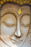 Buddha face sculpture. On temple wall Stock Images