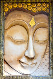 Buddha face sculpture. On temple wall Stock Photo