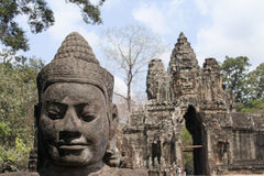 Buddha face at southgate of Angkor Thom Stock Photo
