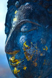 Buddha face, Sukhothai, Thailand. Blue. Royalty Free Stock Photo