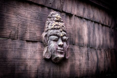 Buddha face in wall Royalty Free Stock Image