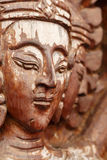 Buddha face,wood-carving of the old wooden door in Thai temple. Stock Photography