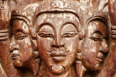 Buddha face,wood-carving of the old wooden door in Thai temple. Royalty Free Stock Photography