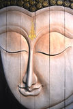 Buddha face wood carving, Thai style. Stock Images