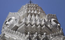 Buddha faces soaring into blue sky at Wat Ratchapradit Royalty Free Stock Image