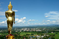 Buddha Facing the entrance city. Sculpture buddha standing golden and facing sky from Nan in Thailand stock photography