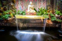Buddha Falls. Shimmering buddha waterfall in a koy pond Stock Photo