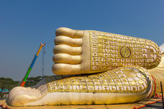 Buddha feet. Reclining buddha feet in thai temple under construction Stock Photos