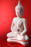 Buddha figure with  a butterfly Stock Photos