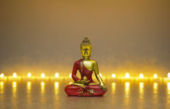 Buddha figure in meditation with candle lights Stock Photos