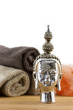 Buddha figure with towels on the background Royalty Free Stock Photos