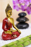 Buddha figure in ZEN garden Royalty Free Stock Photos