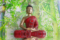 Buddha figurine on bamboo background Royalty Free Stock Photography