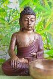 Buddha figurine on green bamboo background Stock Images