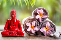 Buddha and flower in towels Royalty Free Stock Photography